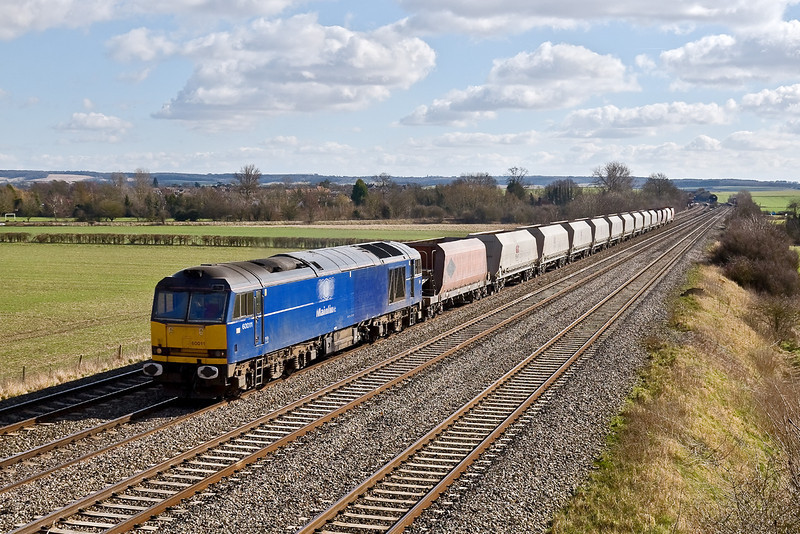 2nd Mar 09:  60011 runs west past Manor Farm in Cholsey with the 6B35 from Hayes to Moreton on Lugg in beautifull sunshine,