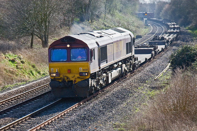 24th Mar 09:  Storming out of the light is 66221 and 4M36 the 13.10 from Southampton to Birch Coppice Intermodal as it runs through Silchester