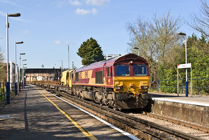 30th Mar 09:  Not often used as a photographic location is Egham Station. Here 66012 working 6Y41 from Eastleigh to Hoo Junction passes through.