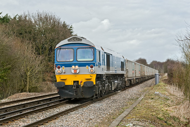 11th Mar 09:   59002 rattles down the hill towards Wokingham with the returning empties from Sevington to Whatley.  Captured here at the Waterloo Road level crossing.