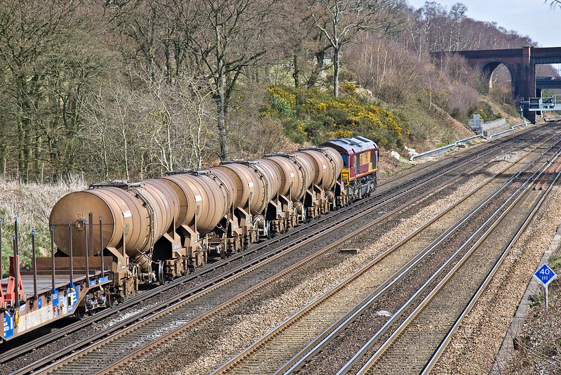 30th Mar 09:  The last loaded Calcium Carbonate tanks from Quidhampton head up the hill towards Winchfield with 66193 on the front.