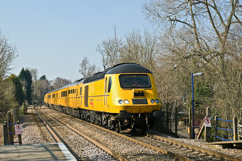 19th Mar 09:  43014 & 43062 on the NMT. 1X22 ran from Reading West Junction Yard to Old Oak Common via Aldershot, the Pompey Direct to Portsmouth, Guidford, Reading and Ascot. Seen here racing down the hill through Sandhurst