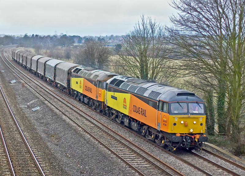 12th Mar 09:  The first run of the new Colas steel contract saw the empties being returned to Dollands Moor.  In awful light 47739 & 727 hurry through Lower Basildon