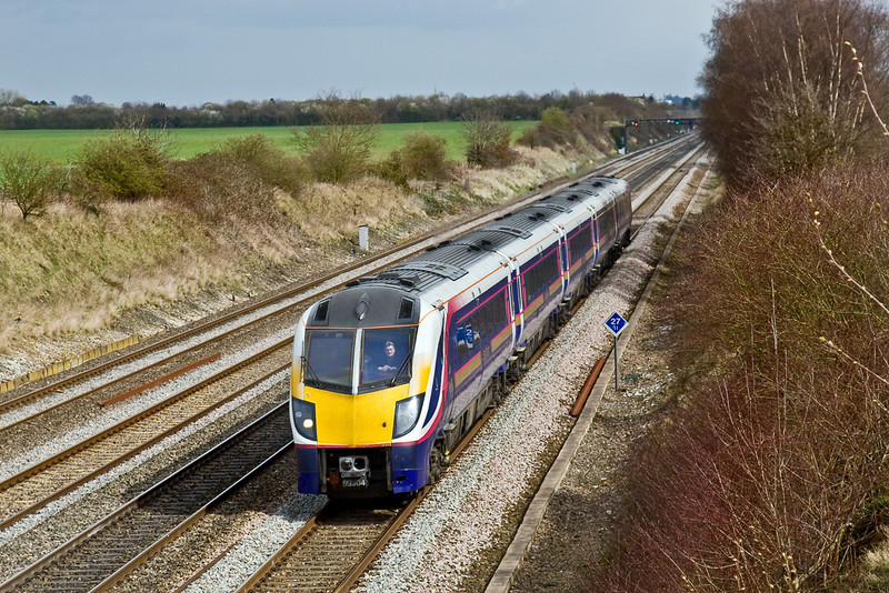 27th Mar 09: 'Look, No hands'!  On the last official day for FGW to use Class 180 Adelantes the driver of 180104 takes the limelight as 1W29 the 11.22 to Great Malvern races through Shottesbrooke