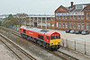 31st Mar 09:  66152 in the new DBSchenker livery stands in front of the old Eastleigh works offices.
