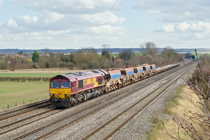 2nd Mar 09:   Cholsey station is in the background as the afternoon deaprtmental from Eastleigh to Hinksey, headed by 66169, nears the Manor Farm bridge.