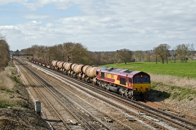 30th Mar 09:  Today marks the last time that the loaded Calcium Carbonate tanks will be worked forward to Wembley on the 6M44 Enterprise service from Eastleigh. Captured here at Totters Lane between Hook and Winchfield.
