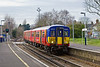 7th Mar 09:  96 years after the line was first electrified the 15.11 from Shepperton to Waterloo crosses Percy Road and enters Hampton Station.