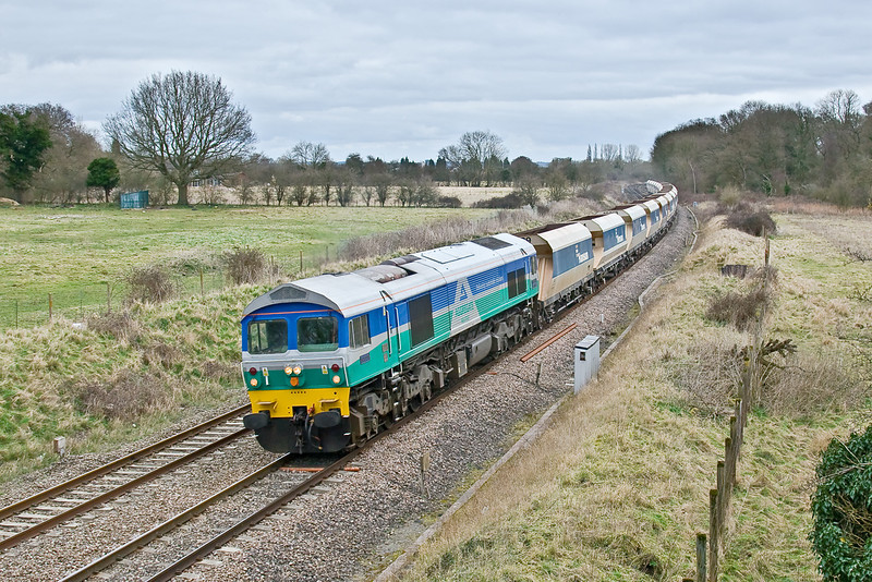 13th Mar 09:  Adorned with the Agregate Indusries livery 59005 heads west away from Aldermaston working 7C74 from Theale to Whatley
