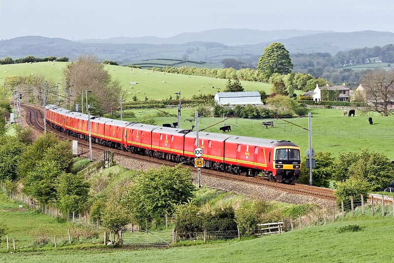 7th May 09:  The 1M44 16.16 Postal Service from Shieldmuir to Warrington is in the hands of 323004/011/013 and is captured here racing through Rowell