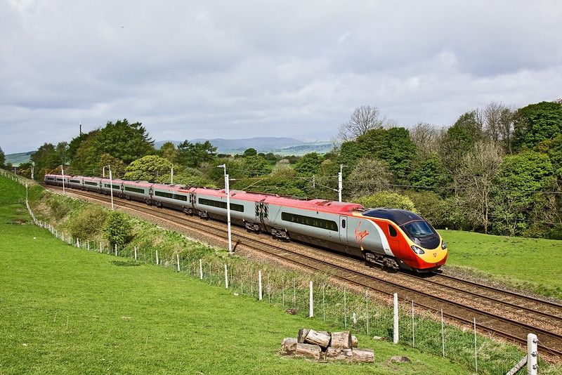 7th May 09: Pendolino 390048 charges through Beck Houses on it's way to Glasgow from Euston