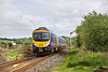 7th May 09:  185116 nears Burneside Level Crossing on the Windermere Branch. 1C75 is the 15.04 from Preston