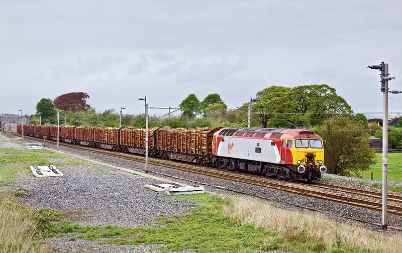 6th May 09: The Carlisle Yard to Chirk Logs hammer through  Elmsfield  with 57303 Alan Tracy in command.