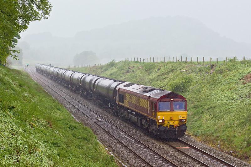 6th May 09:  In driving rain 66142 powers 6E32 from Preston Docks to Lindsey towards Pleasington