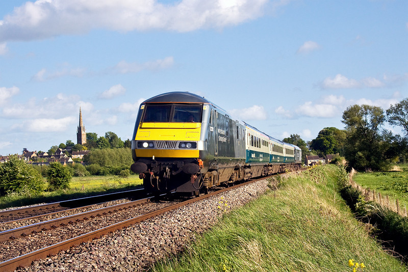 8th May 09:  The 16.33 from Marylebone to Wrexham (1J83) headed by DVT 82301 and pushed by 67010  races through Kings Sutton in beautiful evening light.
