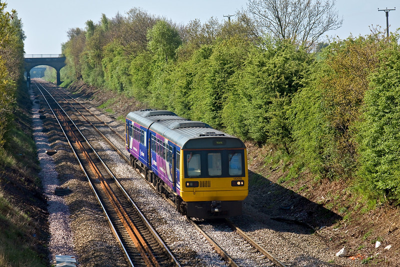 29th Apr 09:  The 09.29 from Sheffield is scheduled to run through to York formed of 142025. However on this day it was terminated at Moorthorpe. Captured here starting the rum downhill away from Thurnscoe.