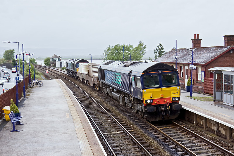 6th May 09:  The Wednesday only flasks from Sellafield to Heysham, 6C52, eases through Arnside Station on a very wet afternoon.  TnT by 66426 & 66425