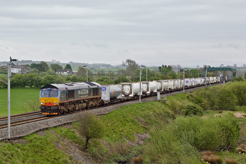 6th May 09:  DRS 66412 in Malcolm livery is on the point of 6S44 from Daventry to Coatbridge. Captured here at Elmsfield