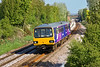 29th Apr 09:  144009 nears the top of the rise from Moorthorpe at THurnscoe working 2Y19, 0948 from Leeds to Sheffield.