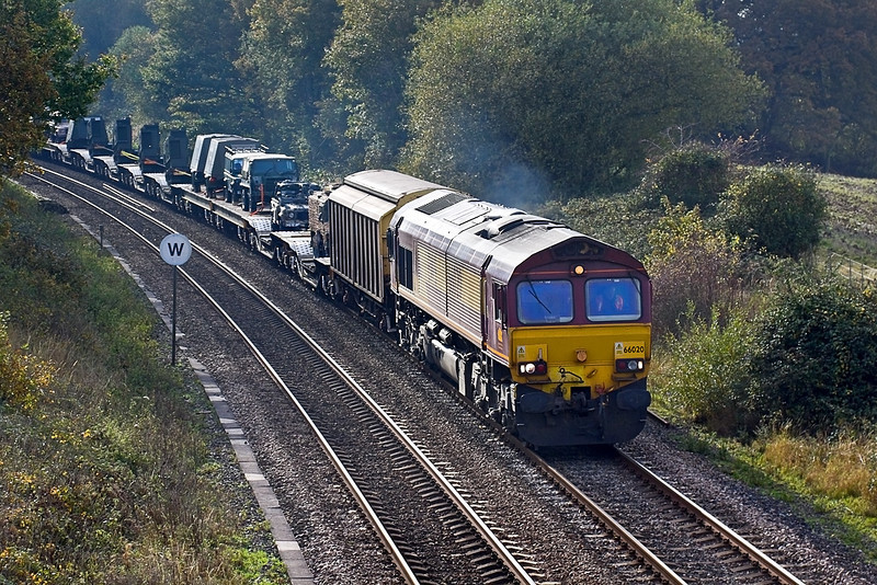 30th Oct 09:  The as required MoD service from Marchwood to Didcot is trusted to 66020.  With a good load, it climbs through Silchester