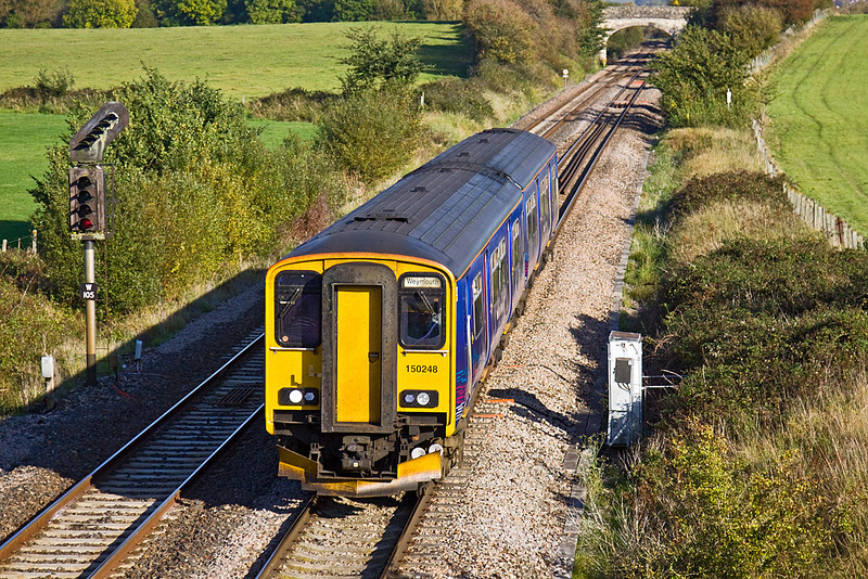 14th Oct 09:  The 12.51 from Great Malvern to Weymouth (2O90) is formed of 150248.  It is captured here departing from Westbury