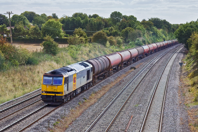 10th Sep 09:  Newly re-instated 60073 powers 6B33 Empty oil tanks from Theale to Robeston past Spring Farm