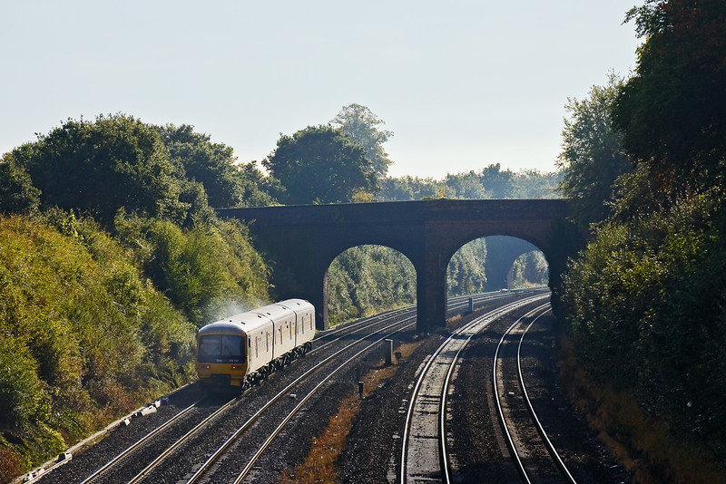 26th Sep 09:  165102 forming the 08.37 from Oxford to Paddington (2P36) catches the light as it moves away from Westbury Lane in Purley and makes for it's next stop at Tilehurst