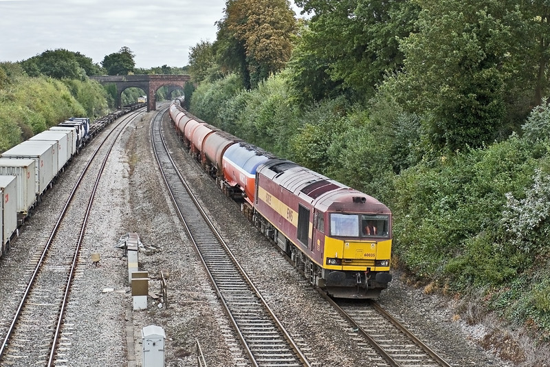 22nd Sep 09: 14 seconds later and with 66579 in the distance tug 60035 is working 6B33 the empty Murco oil tanks from Theale to Robeston.  Captured here on the main line through Purley on Thames