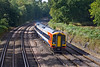 21st Sep 09:  1L38 the 11.45 from Salisbury to Waterloo formed of 159018 rounds the corner at Curzon Bridge at Pirbright