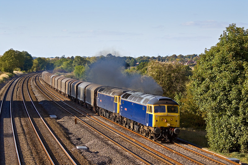 24th Sep 09:  47805 & 47839 from Riviera Trains again work 6Z48 from Burton on Trent to Dollands Moor on behalf of Colas. They were following the local Turbo and the driver gave them an armfull as they neared the bridge at Lower Basildon much to the delight of the gallery.