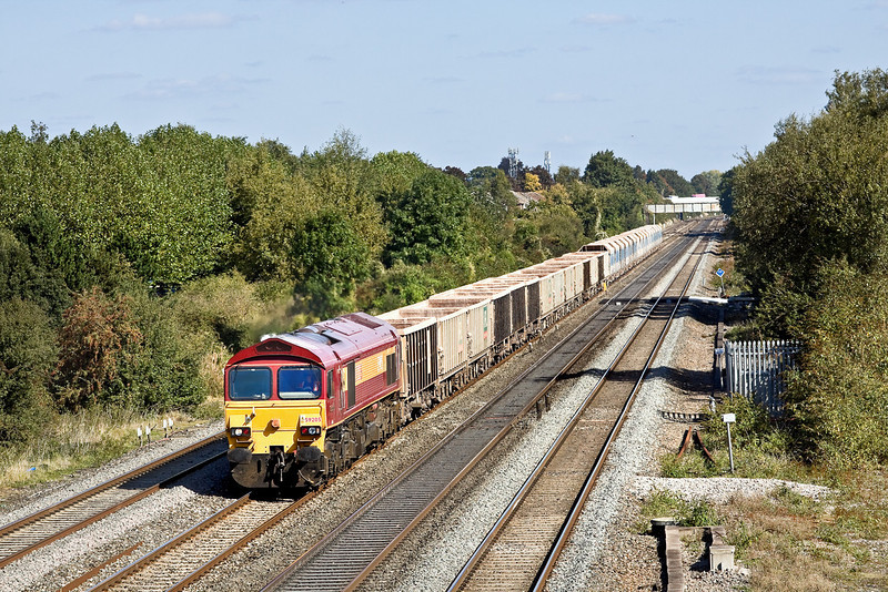 25th Sep 09:  59205 in charge of 7C77 from Acton to Merehead empties rumble away from Maidenhead.