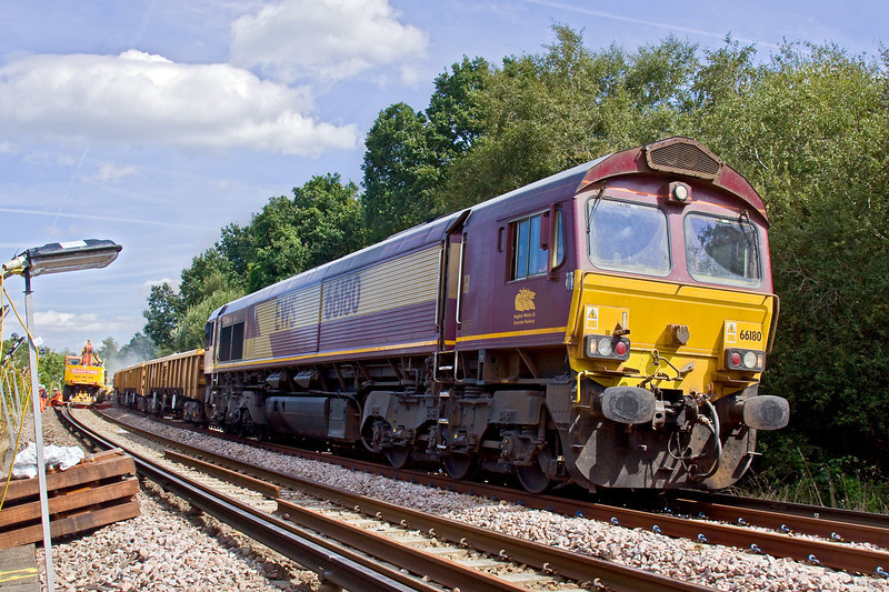 23rd Aug 09: Waiting to depart at the rear of the Sainsbury Supermarket in Watchmoor Park is 66180