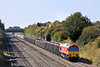 25th Sep 09:  With 4000 tonnes on the hook 59206 trundles quietly up the Relief towards Acton.  Seen here  from the bridge at Breadcroft Lane in Maidenhead