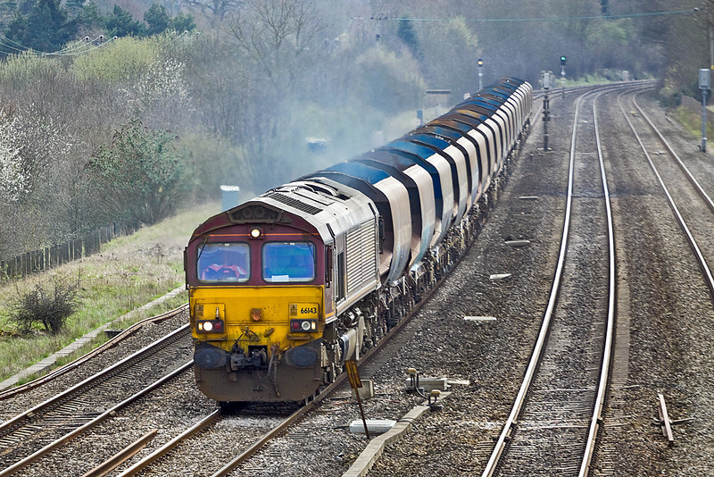 6th Apr 10:  66143 heads a very dirty rake of 20 Bardon Hoppers working from Wembley to Moreton on Lugg through Lower Basildon