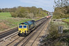 22nd Apr 10:  Running down the short drop between Winchfield and Hook is 66537 at the helm of 4O35 from Crewe to Eastleigh