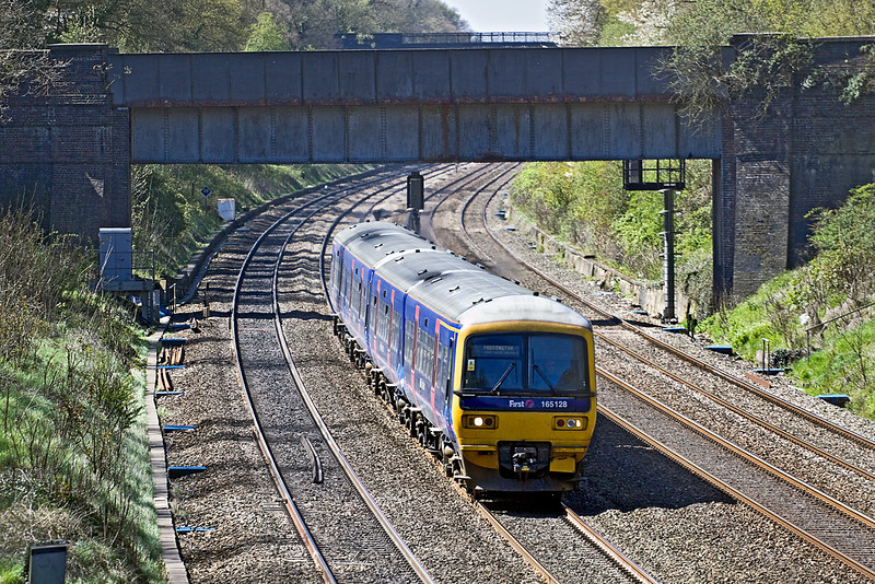 21st Apr 10:  The 12.31 from Oxford  calls only at Reading and Slough. Doing the honours today is 165128, seen here nearing the end of the Sonning Cutting.