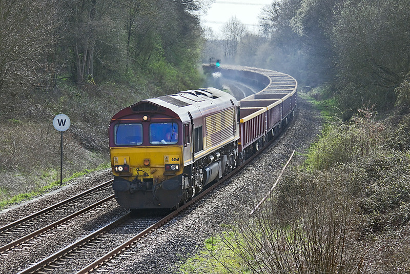 10th Apr 10:  Roaring up through Silchester is 66161 with a long  rake of spent ballast in MLA wagons.6N02 is bound for Hinksey Yard
