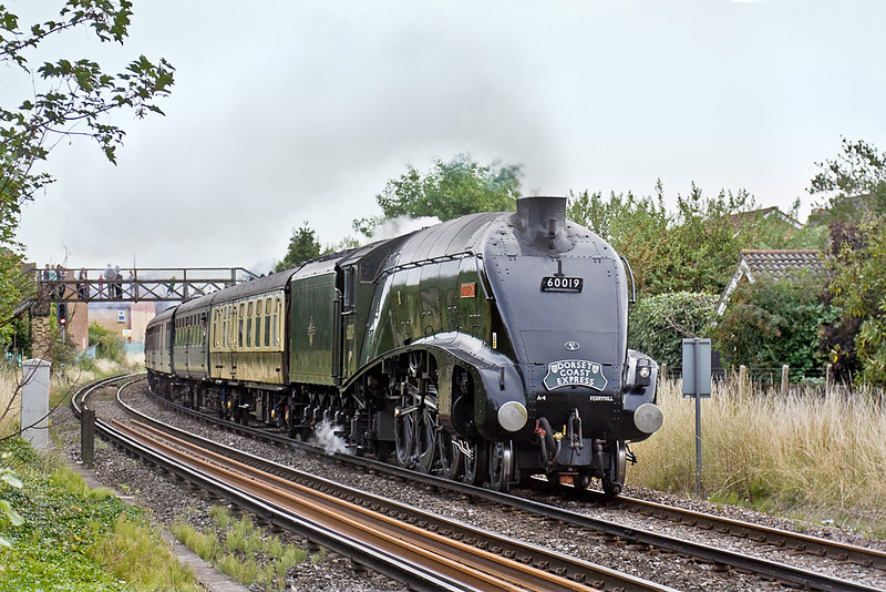 "25th Aug 10:  It is LNER A4 Pacific 60019 ""Bittern""s turn to take the outward leg of the 'Dorset Coast Express' from Victoria to Weymouth. In dry but poor conditions the train is captured storming away from Egham"