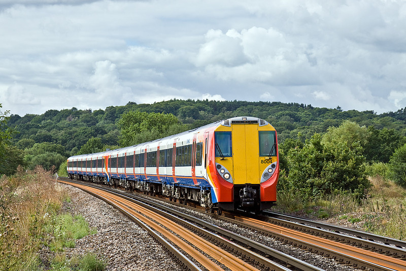 5th Aug 10:  Nearing Prune Hill on the edge of Egham are 458004 & 458026 working the 09.42 from Reading to Waterloo