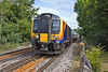 5th Aug 10:  Rounding the curve at Prune Hill in Egham is 450557 working 2S21 the 09.22 to Weybridge from Waterloo via Hounslow