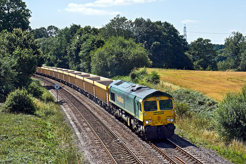 9th Aug 10:  66615 is tasked with taking the empties back to Stud Farm from Eastleigh.  Seen here at Silchester