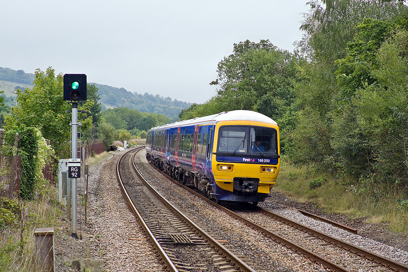 20th Aug 10:  The 13.34 from Redhill to Reading slows for the Gomshall stop.  166203 is running as 2V62