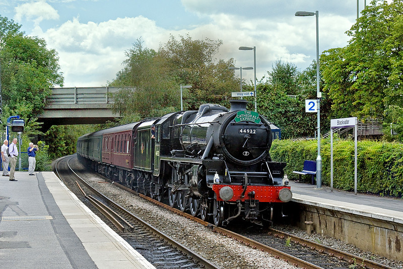 "12th Aug 10:  44932 is rostered for the ""Cathedrals Express""  from Victoria to Gloucester.  Routed via the Surrey Hills the train is seen here crwaling through Blackwater hard on the heals of a FGW Turbo stopping service."
