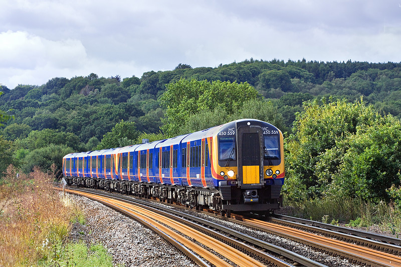5th Aug 10:  The 10.03 from Weybridge to waterloo nears Egham lead by 450559