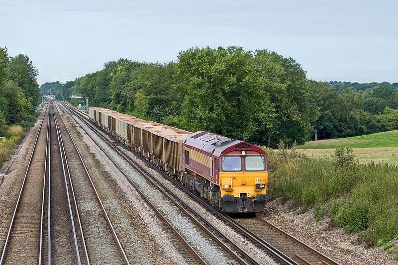 18th Aug 10:  59201 plods along the slow up the rise between Hook and Winchfield with 7O12 from Merehead tp Woking