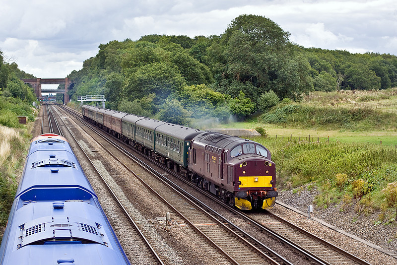"18th Aug 10:  Emergency stand in for 44932 is 37706 working the ""Cathex"" to Weymouth from Waterloo.  Seen here from the Totters Lane bridge between Winchfield and Hook.  Running on the Slow is 2L36 the 11.24 from Basigstoke to Waterloo"