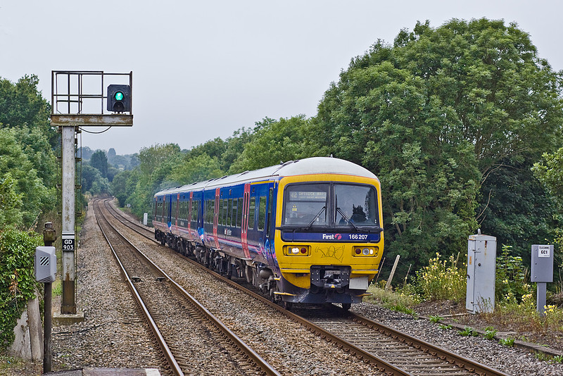 20th Aug 10:  166207 forms 1O70 the 11.34 from Reading to Gatwick Airport.  Seen here running through Gomshall on a very dull afternoon