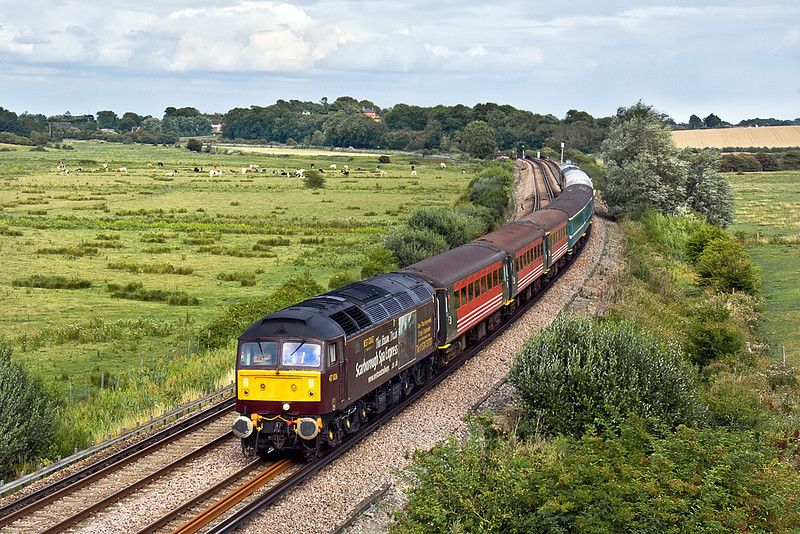 "12th Aug 10: The ""Sussex Coast Statesman"" Powered TnT by 47826 & 47580 is seen here about to pass under the A27 at Beddington"
