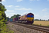 9th Aug 10:  66044 heads north with 4M66 from Southampton to Birch Coppice over the 'Danes' foot crossing in Grazeley