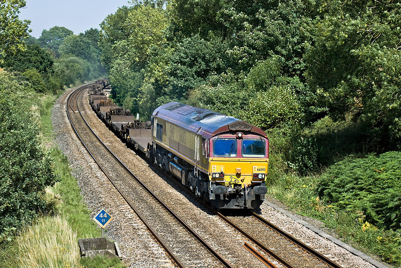 9th Aug 10:  Running a little early 66003 hurries through Silchester with 4O21 from Hams Hall